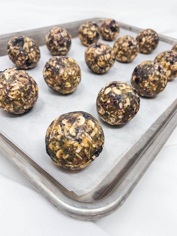 Freshly rolled energy balls on a baking sheet