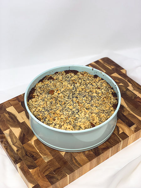 Cake in a pan on top of a cutting board