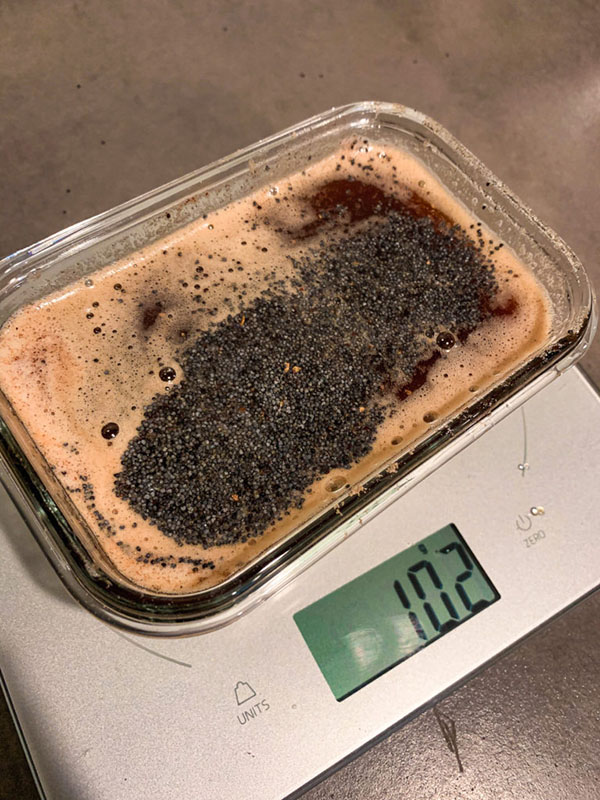 Browned butter being weighed on a scale
