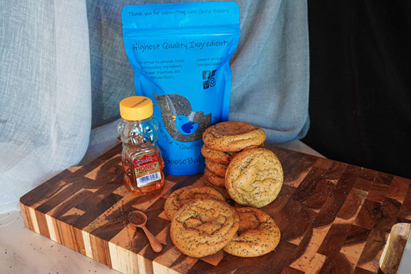 stacked cookies next to poppy seed and honey