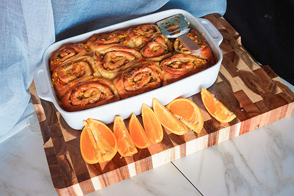 Sweet Orange Poppy Seed Rolls still in the pan