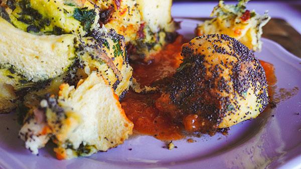 Italian Poppy Seed Pull Apart Bread in a sauce