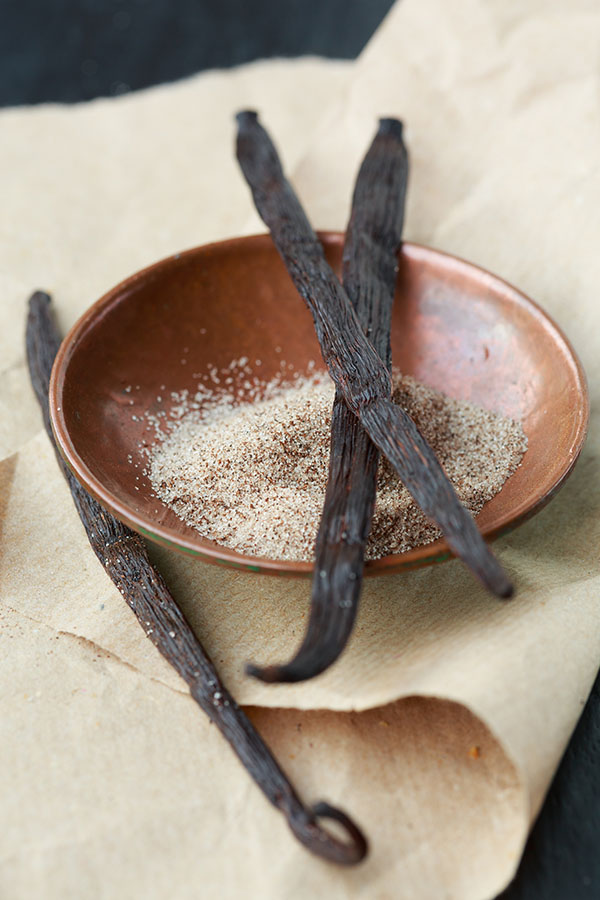 Vanilla beans on top of a bowl