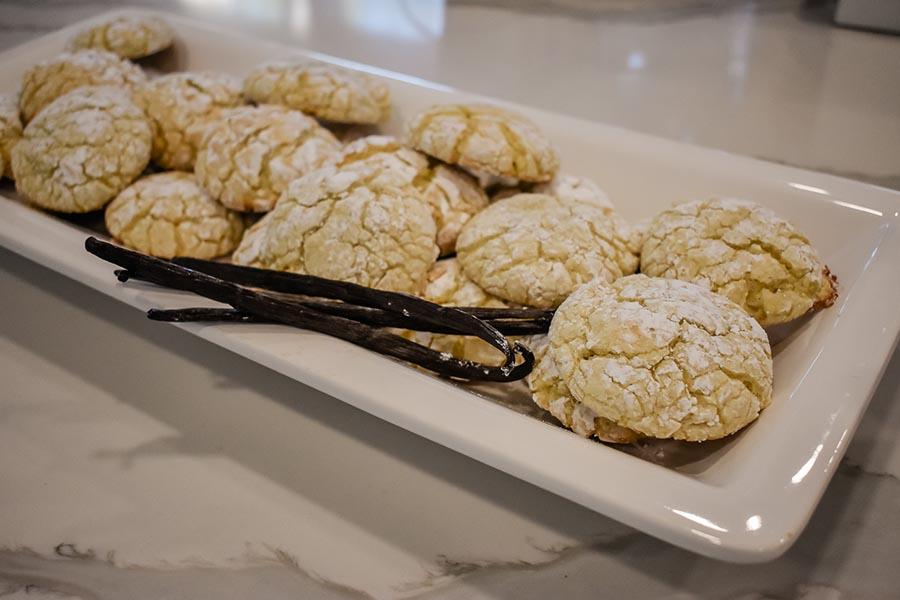 Lemon Goo Goo Cookies on a plate with vanilla beans